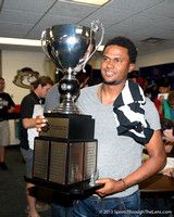 Ydarqui Marte poses with the Championship Cup